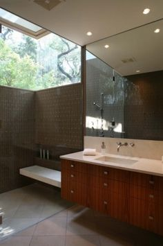 I LOVE THIS SHOWER IDEA! Drool worthy. The light, the height, the contrast of dark material against light nothing. Shower floor could be heavily textured, but must be kept free of build-up tho.