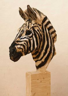 'Zebra' wooden sculpture made by a chainsaw. Artist: Jurgen Lingl Rebetez