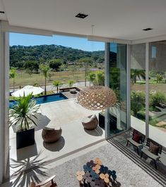 How idyllic is this spot for a large @David Trubridge Kina light? Take us to Brazil! #contemporist #lighting
