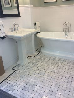 Shot taken at The Tile Shop in Bloomington, MN:  Basketweave floor tile with black boarder; Subway tile with cornice top.