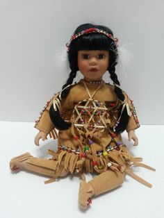 """Collections - Porcelain Sitting Native American Indian Girl Doll with Dream Catcher - 10"""" tall"""