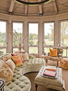 circular wall of operable glazing + vaulted ceiling + stunning curved tufted sofa! oh yesss