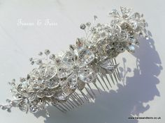 Commissioned wedding hair comb made for a beautiful bride to be who wanted lots of sparkle to match her wedding dress www.tiarasandteirs.co.uk