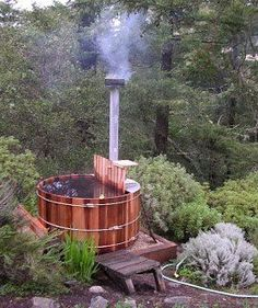 wood burning hot tub This is so awesome! Not only are they less expensive to purchase and maintain than your every day hot tub they are also much more fun. Very fitting for a country home setting :-) sauna hot tub Yurt Living, Outdoor Living, Outdoor Decor, Barris, Different Types Of Wood, Cabins In The Woods, Outdoor Projects, Spas, My Dream Home