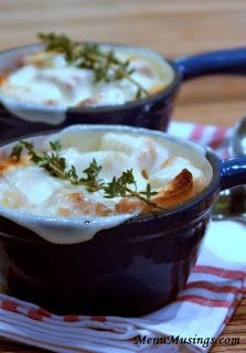 French Onion Soup - a rich beef broth enhanced by red wine, fresh thyme, caramelized onions, toasted French bread croutons and gooey melty cheese!  YUM!!! Step-by-step photo tutorial included in recipe.
