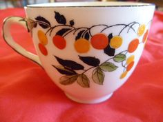 Doulton Deco: unnamed tea cup, H1287, Rd 722923, c1920s. Orange and yellow fruit pattern with green and black leaves and black branches, highlights, trim and twisted handle feature. Hand-painted variant of unnamed pattern (H3885), and similar to Flambe (H2886) and Mountain Ash (H2885) patterns.