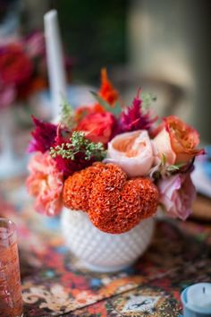Wow! That cockscomb Celosia is gorgeous! Love all the colors and the milk glass container too.
