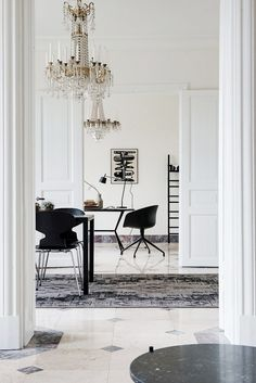 Glamorous and luxurious space with tiled floors and crystal chandelier