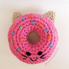 "Our signature donut is sure to be a hit with your feline friends and will provide hours of catnip filled fun!  This listing is for one (1) crochet catnip donut. It is handmade from 100% acrylic yarn and filled with organic catnip and poly fiberfill.  Measures approximately 3 1/2"" in diameter...."