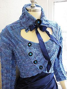 Pattern is Rivulet by Andrea Marquis.  Love the cables and the collar.