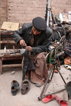 Shoe repair . Kashgar China