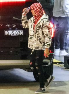 Justin Bieber in Australia Wearing Supreme x Louis Vuitton Hoodie, Supreme Thrasher Hoodie, Amiri Jeans and Vans Sneakers | UpscaleHype