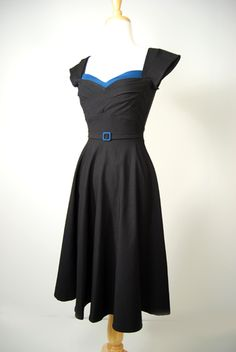 """I don't if this would be flattering on me, but I'd love to have a classic styled dress like this. Maybe not """"in style"""" -but almost always a classic that work for a nice dinner party, etc.    .....    Lovely 40's style dress."""