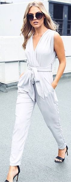 Try a grey tie-front jumpsuit for work this summer. Let Daily Dress Me help you find the perfect outfit for whatever the weather! dailydressme.com/