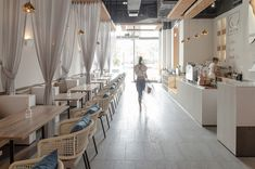 101 café / FAR OFFICE, China. White clean and modern cafe with curtain dividers