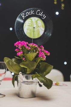 Vinyl table numbers and centerpieces (with gerbera daisies in mason jars with rocks at bottom of jars) Music Centerpieces, Party Centerpieces, Wedding Decorations, Table Decorations, Wedding Music, Our Wedding, Homemade Posters, 50s Theme Parties, Rock Star Party
