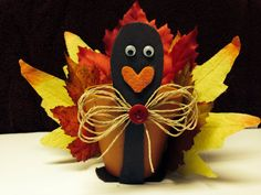 Turkey made out of clay pot.   Thanksgiving Craft to do with the kids. It could be a candle holder to decorate your table for thanksgiving. Please make sure to use battery operated candles, for your safety.holiday thanksgivingkids craftschool craft #thanksgiving #easythanksgiving #kidsthanksgiving #schoolcraftforthanksgiving #roomparentideas