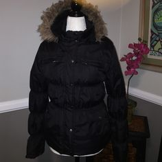Warm puffer jacket So warm and cozy. This jacket is lined with faux fur for extra warmth. Front zip and snap to keep the elements out. Faux fur-lined, detachable hood. Two zippered breast pockets and two side hand pockets. Cute elastic detail throughout. Maralyn & Me Jackets & Coats Puffers