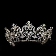Cartier | Tiara | c. 1903  This tiara of graduated flaming hearts and C scrolls was inspired by a vision of France before the Revolution.