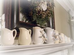 Vintage pitcher collection - pretty all in white with matching accessories.