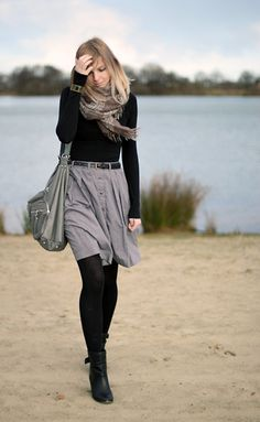 I love the skirt, but I'd add a pop of color here - a bright scarf, belt, or even handbag.