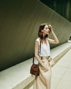 Three summer styles for now and later: Ann Taylor's belted twill mini skirt, sleeveless wrap blouse and suede bucket bag.