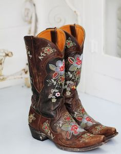 Brown boots with red flowers....flowers POP off the boots.