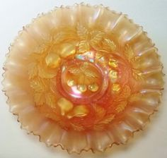 To price this item and view our other outstanding offerings, we invite you to visit our online store located at http://www.longbrookantiques.com  We proudly offer for sale this Antique NORTHWOOOD Carnival Glass CHAMPAGNE (base glass color) with PASTEL MARIGOLD THREE FRUITS Plain Back Plate. This example has a wonderful amount of PINK to the extremely colorful iridescent finish. The base glass is not clear but indeed is a Champagne color. A striking Pie Crust shaped Edge makes this a must…