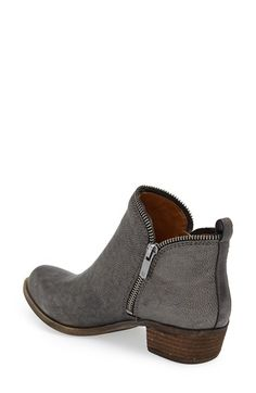 Free shipping and returns on Lucky Brand 'Bartalino' Stud Embossed Leather Bootie (Women) at Nordstrom.com. Edgy zipper teeth trace the topline of a lightly textured leather bootie detailed with pyramid-stud embossing in back and boosted with a low, stacked heel.