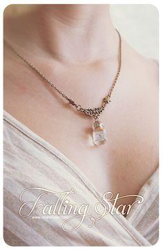 Swarosvki star Tiny glass Bottle Necklace, with glitter stars. Glass Vial necklace miniature Bottle Pendant Cute Necklace. €12.99, via Etsy.