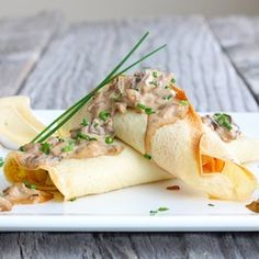 Crepes stuffed with brie, ham and asparagus with creamy mushroom sauce.