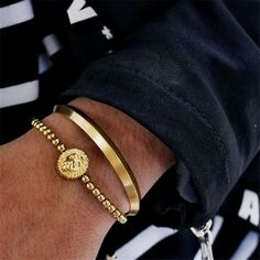 If you're looking for a sleek, minimal bracelet that encompasses an easy to style look with designer features, this bangle is the one for you. Mens Gold Bracelets, Gold Bangle Bracelet, Gold Bangles, Fashion Bracelets, Dainty Bracelets, Jewelry Bracelets, Gold Rings Jewelry, Jewelery, Fitness Bracelet