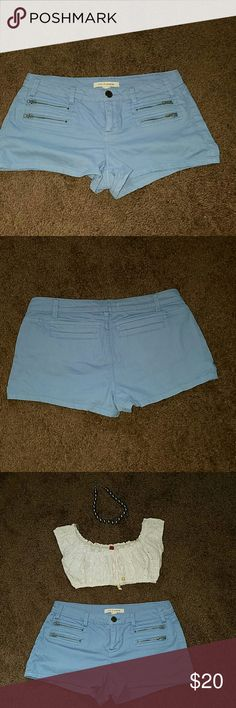Blue shorts Soft denim ocean blue shorts. Size 27 it has stretch very cute with a crop top. Shorts Jean Shorts