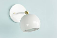 White wall sconce Brass Light multiple colors available $100