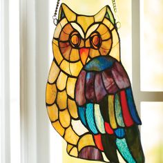 """This cute little owl is quite a """"hoot"""" with his colorful Tiffany-inspired glass detailing. Add this window panel to your home and let beautiful light shine through and  bring it to life."""