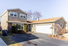 Residential property for sale in Lombard,IL (MLS #09656463). Learn more from Touchstone Group.  Pergo flooring in living room and dining room.