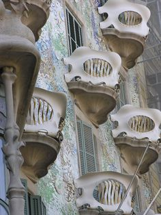 Casa Battlo, Barcelona.  The balconies remind me of Venetian carnival masks. Or those sea creatures that live in no light.