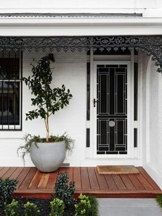 Natalie Doherty and Grant Edhouse - The Design Files House With Porch, House Front, Front Verandah, Small Front Porches Designs, Front Door Plants, Weatherboard House, Front Porch Design, Front Door Entrance, Small Front Porches