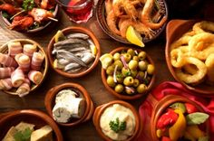 """Tapas means """"one bite"""" but there are SO many little dishes to choose from!  Meats wrapped with fruit slices, deep fried tender veggies, salted olives...Heaven!"""