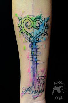 rainbow key watercolor tattoo