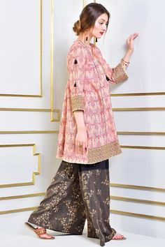 <p><b>Printed Front and Back ,full sleeve shirt with tassels<br /></b><b>Embellished Border at Shirt Hem and Sleeves Opening<br /></b><b>Box Pleat Flayer at Back <br /></b><b>Finishes of Gota lace</b></p>