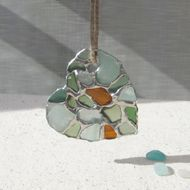 Seaglass heart made with natural seaglass collected on UK beaches with hand woven natural cord. As seaglass is tumbled and frosted by the sea, no two pieces are ever the same, so each heart made is unique.
