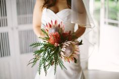 King & pincushion protea bouquet | SouthBound Bride | http://www.southboundbride.com/fynbos-gold-foodbarn-wedding-by-illuminate-photography | Credit: Illuminate Photography