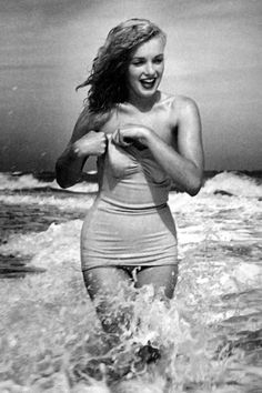 Marilyn Monroe....Swimsuit MM are some of her most natural, most personal photos, no?  Just lovely!