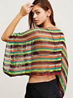 Kingston Crochet Poncho | Colorful wide knit crochet poncho featured in a pullover style with a boat-neck and cropped silhouette. Ruched detailing on the sleeves with adjustable ties.