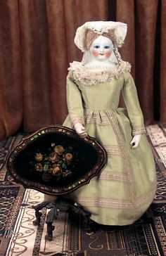 Theriault's Antique Doll Auctions - Very Beautiful French Porcelain Glass-eyed Lady Doll Attributed to Leontine Rohmer, circa 1860 with French Miniature Tilt-top Table with Hand-Painting and Inset Mother-of-Pearl Decorations