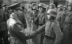 Joseph Goebbels and a 15-year-old Hitler Jugend soldier in Silesia, 1945.