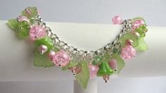 Made of different pink and green Czech glass beads and hearts, pink crackle glass beads, green acrylic leaves/flowers and little soft pink freshwater pearls.