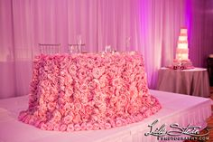 Over 1,000 fresh roses for sweetheart table! Beautiful design from Fayaz at Bloombox Design. Cake from Sweet and Saucy.
