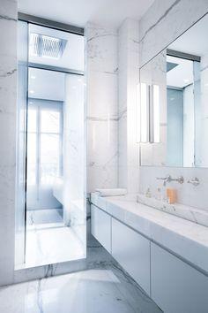 sleek marble trough sink // via A Modern Apartment Near The Eiffel Tower